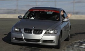 Our man Mark Vaughn drives a Bimmer with no hands on a racetrack.