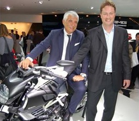 Ducati CEO Gabriele Del Torchio straddles the Ducati Diavel AMG Special Edition, next to AMG president Ola Kallenius. (Photo by Mark Vaughn.)
