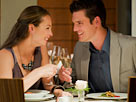 Image: Couple toasting champagne glasses at restaurant table (© Chris Ryan/OJO Images/Getty Images)