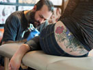 Tattoo artist at work (© Helen King/Corbis)