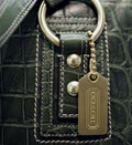 Credit:  Daniel Acker/Bloomberg/Getty Images&#10;Caption: A Coach handbag sits on display in the Coach flagship store
