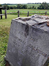 A gravestone marker on the spot where the arm of General Stonewall Jackson is buried is near the Ellwood house in Locust Grove, Va. Civil War history will play out in a rural Virginia courtroom this week when Wal-Mart Stores Inc. defends a planned store near the hallowed site where Robert E. Lee and Ulysses S. Grant first met on a battlefield in 1864 (© Steve Helber/AP)