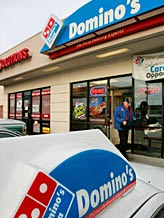 Credit: ( Douglas C. Pizac/AP)&#xA;Caption: Domino's franchise