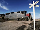 Image: Railroad Crossing with Train (&#194;&#169; Edmond Van Hoorick/Photodisc/Getty Images)