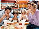 Image: Family eating burgers (&#194;&#169; Bananastock/Jupiterimages)