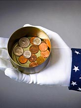 Uncle Sam with a can of coins (© Peter Gridley/Photographer)