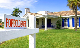 Foreclosure activity fell 21% in November, according to RealtyTrac. (© Tetra Images/Superstock)