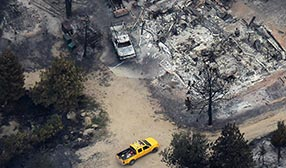 Firefighter's vehicle parked amidst the ruins of homes burned in the September 8, 2010, wildfire near Boulder, Colo. ( John Moore/Getty Images)