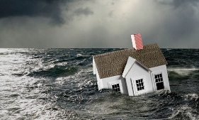 House in stormy water (© Steven Puetzer/Getty Images)