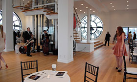 The interior of the 1 Main Street property where the band and guests are touring the property, as seen on HGTV's Selling New York ( 2011, HGTV/Scripps Networks, LLC. All Rights Reserved)