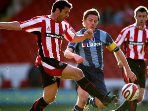 Challenging Gary for possession for Charlton against Sheffield United in 2008