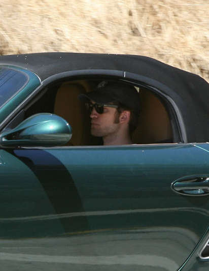 Rob driving a new Porsche